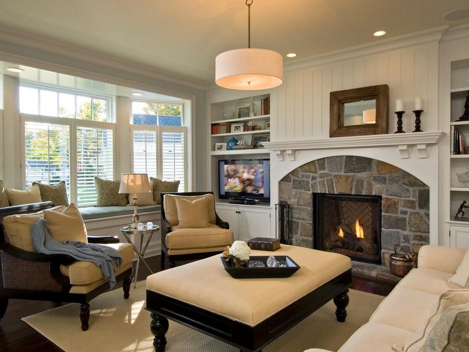 Интерьер в частном доме: дизайн гостиной с камином