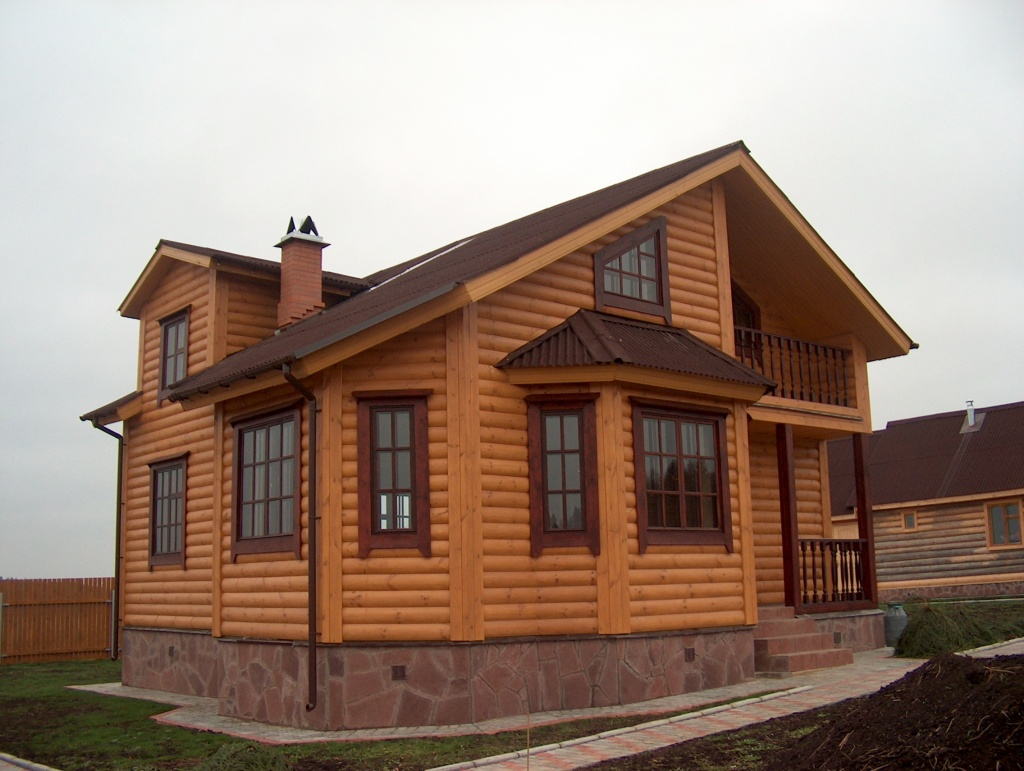 Обшивка каркасного дома имитацией бруса