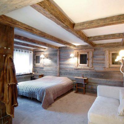 Интерьер спальни в стиле инималистичного шале