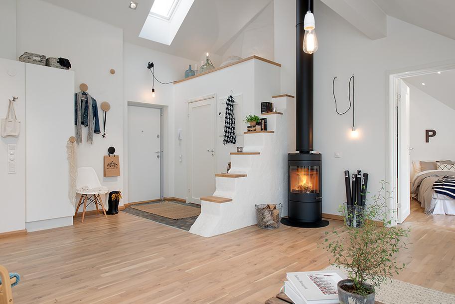 Очень часто скандинавские прихожие бывают совмещены с гостиной