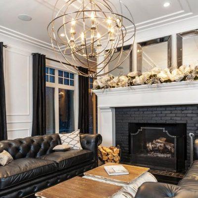 Разновидность люстра в интерьере гостиной комнаты современного стиля