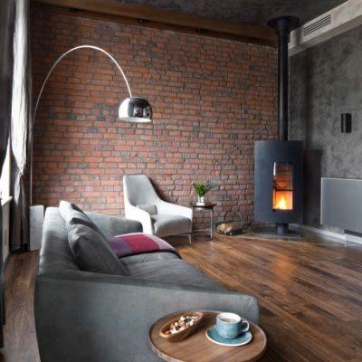 Угловой камин в гостиной стиля лофт
