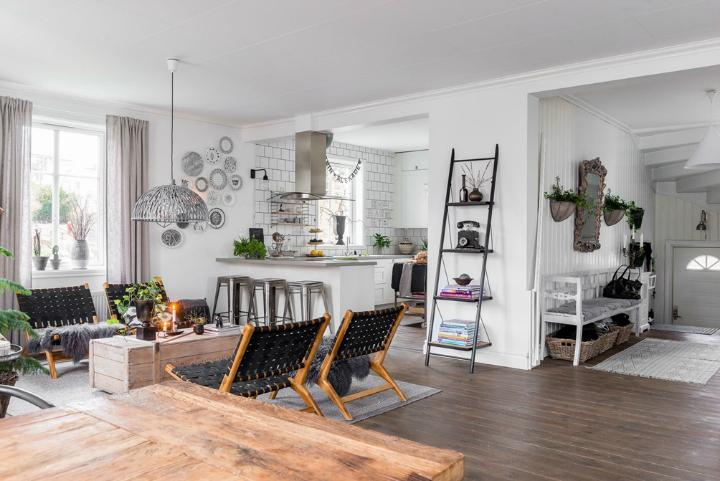 Скандинавский интерьер позволяет совмещать как порстую мебель грубой работы, так и авторскую