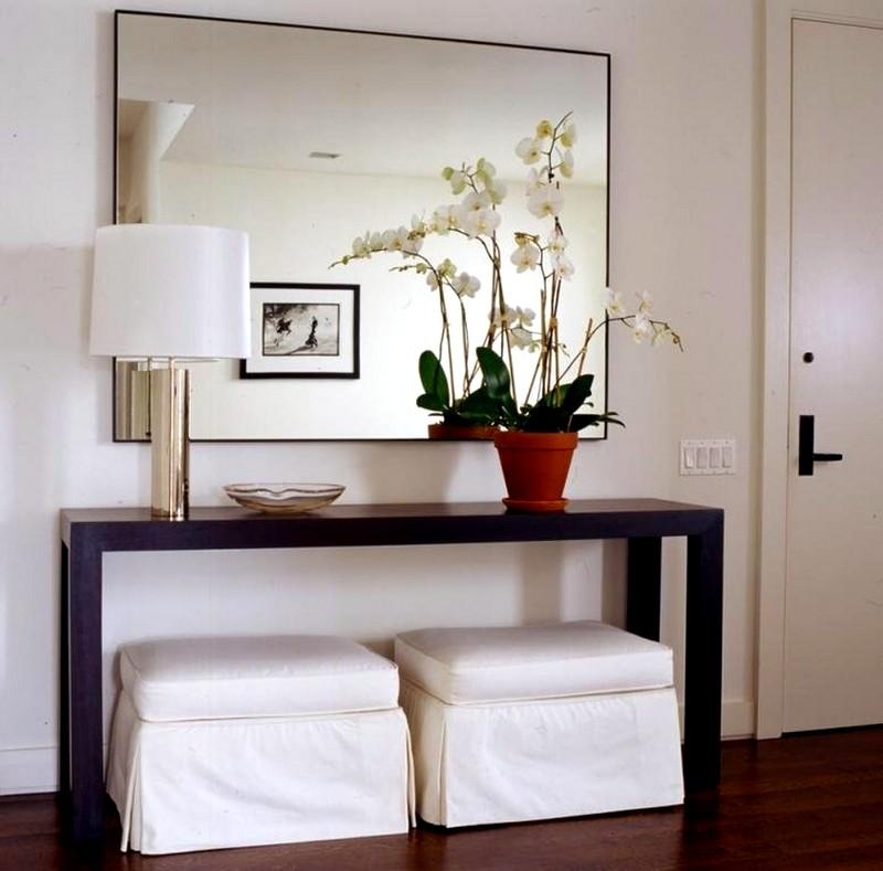 зеркало в спальне с отражением картины