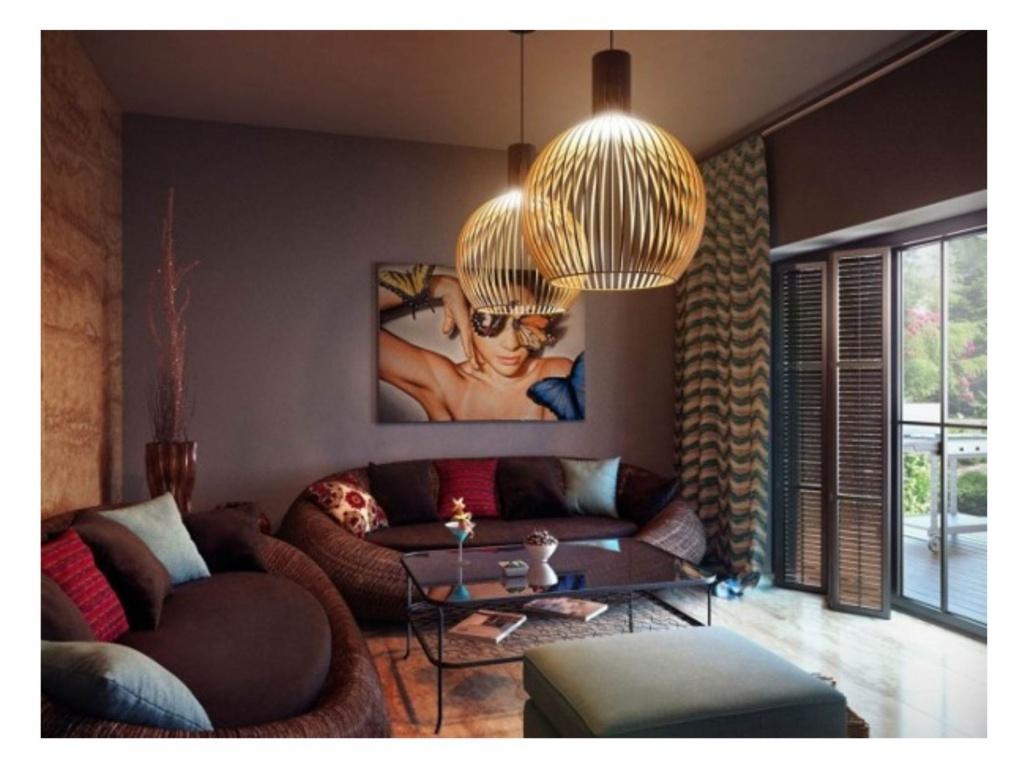 Люстры для гостиной в современном стиле: яркая деталь интерьера