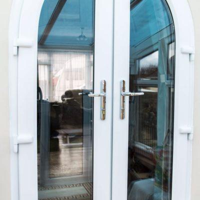 Пластиковые арочные двери